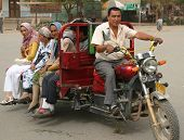 A Uyghur man driving a public taxi in Kashgar, China