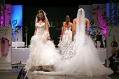ZAGREB, CROATIA - OCTOBER 3: Fashion models in wedding dress walk down the runway on 'Wedding days'