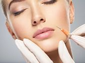 Woman getting cosmetic injection of botox in cheek, closeup. Woman in beauty salon. plastic surgery  poster