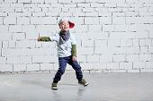 Cheerful Child Boy Dancing To Music. Cool Boy Hip Hop. Cute Fashionable Naughty Kid. Little Rapper M poster