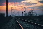 Sunset On The Railroad Tracks Landscape. Traveling By Train On Railroad In Sunset. Railroad Tracks L poster