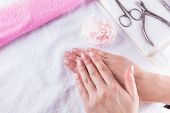 Closeup Shot Of Female Hands With French Manicure On A Towel, Manicure Set. poster