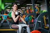 Beautiful Fitness Woman Lifting Barbell. Sporty Woman Lifting Weights. Fit Girl Exercising Building  poster
