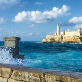 image of el morro castle  - The castle of El Morro in Havana with a stormy weather and big waves crashing against the wall - JPG