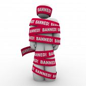 The word Banned in red tape wrapped around a man symbolizing speech or action that is illegal, forbi