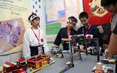 SUBANG JAYA - NOV 10:Unidentified students from Japan show a remote sensing robotic system that cont