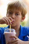 Funny Little Boy Drinks Milkshake