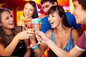 pic of congrats  - Portrait of joyful friends toasting at birthday party with focus on two happy girls - JPG