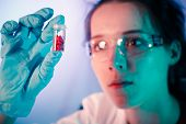 pic of placebo  - Laboratory assistant holds a bottle of pills in her hand - JPG