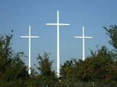 stock photo of forgiven  - These three crosses are standing tall on a gorgeous day in Baton Rouge Louisiana - JPG