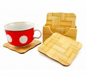 Colored Cup And Set Of Wooden Trivets