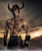 stock photo of battlefield  - Moodey portrait of a muscular man as ancient warrior on battlefield - JPG