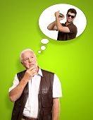 Senior Man Thinking About Man Holding Shaker On Green Background