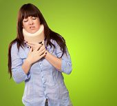 Woman Wearing Neck brace Isolated On Green Background