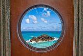 Ocean And Rock Through Porthole