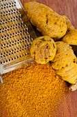 pic of curcuma  - Turmeric curcuma root and powder with steel hand grater - JPG