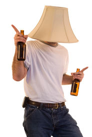 stock photo of lamp shade  - A drunk man dancing to some music - JPG