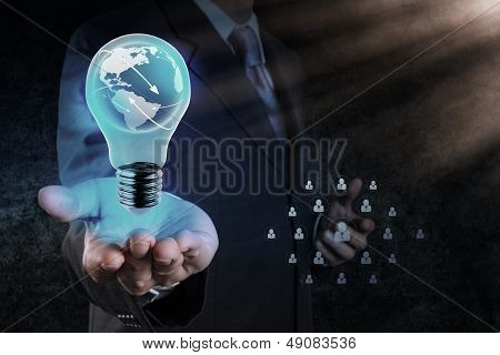 Businessman's Hand Shows Light Bulb With Planet Earth as a Social Network poster