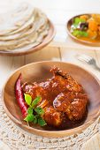 Indian chicken curry and chapatti roti, fresh cooked, Indian dish.