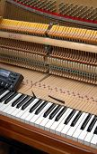 picture of tuning fork  - Upright Piano during tuning. Please see my other photos of a piano being tuned: - JPG