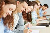 Students taking exam in seminar of an university