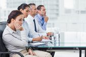 foto of boring  - Businesswoman in bright office getting bored while attending presentation - JPG
