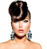 Fashion Model Girl Portrait with Blue Eyes and Earrings. Creative Hairstyle. Hairdo. Make up. Beauty