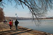 People Walking On Embankment