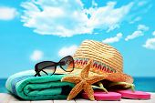 foto of girly  - summer beach accessories on sandy beach - JPG
