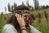 Hippie Men Speak On The Mobile Phone
