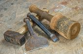Various mason tools on a sandstone slab