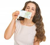 Young Woman Sniffing 100 Euros Banknote
