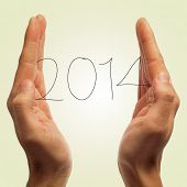 man with the number 2014, as the new year, in his hands on a white background