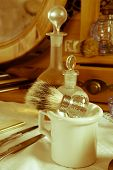Old times barber shop with shaving brush and other antique tools