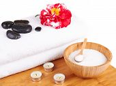 Spa Setting With Candles, Camellia Flower, Towel, Salt And Stones