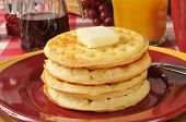 pic of buttermilk  - A stack of hot buttered waffles with coffee and orange juice - JPG