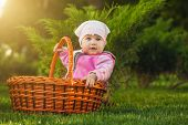 nice baby in basket in the green park
