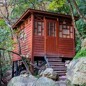 wooden house in the forest at lushan china.