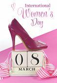 International Women's Day, March 8, vintage calendar and pink high heel shoe.