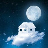 The house from clouds on night sky with moon.