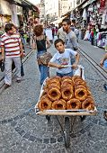 ISTANBUL, TURKEY - JUNE 25, 2010: Grand Bazaar, Unknown Teen sells bagels, June 25, 2010 in Istanbul