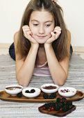 Girl And Sweet Staff With Berries In Porcelain Bowls