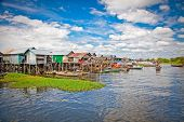 The floating village, caled Komprongpok, on the water of Tonle Sap lake. Cambodia.