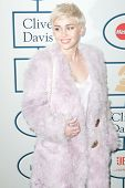 BEVERLY HILLS, CA. - JANUARY 25: Miley Cyrus arrives at the Clive Davis and The Recording Academy annual Pre-GRAMMY Gala on January 25th 2014 at the Beverly Hilton in Beverly Hills, California.