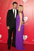 LOS ANGELES - JAN 24: Eddie Cibrian, Leann Rimes at the 2014 MusiCares Person Of The Year event at t