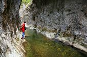 Photographer in Ramet Gorges in the Occidental Carpathians, Romania, Europe