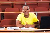 happy male african american college student in lecture room