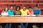 group of happy african college friends in lecture hall