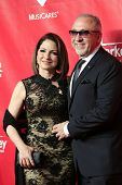 LOS ANGELES - JAN 24: Gloria Estefan,  Emilio Estefan at the 2014 MusiCares Person Of The Year event