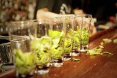 Highball glasses with mint leaves - preparing mojito
